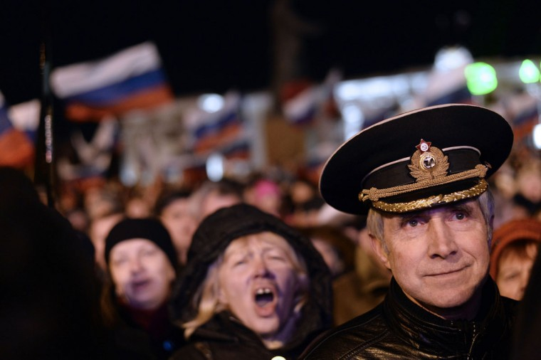 Pro-Russian Crimeans gather to celebrate in Simferopol's Lenin Square on March 16, 2014 after exit polls showed that about 93 percent of voters in Ukraine's Crimea region supported union with Russia. (Dimitar Dilkoff/AFP/Getty Images)