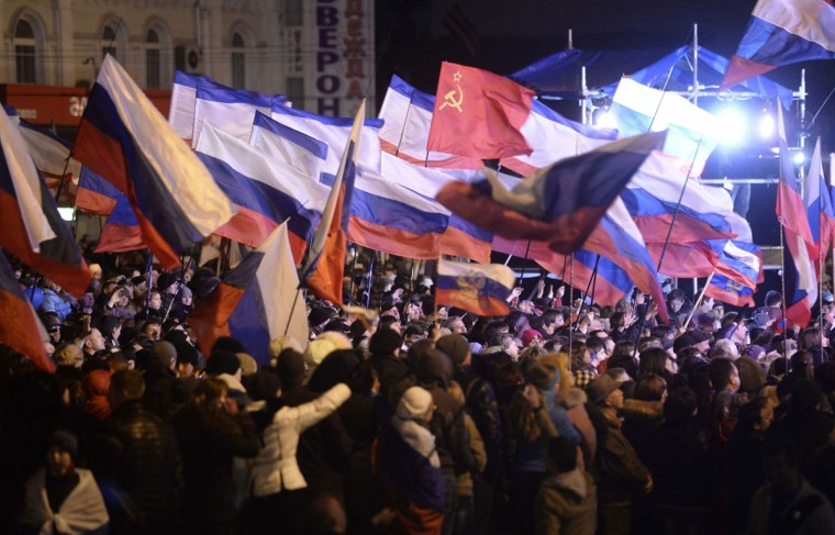 Pro-Russian Crimeans wave Russian flags as they gather to celebrate in Simferopol's Lenin Square on March 16, 2014 after exit polls showed that about 93 percent of voters in Ukraine's Crimea region supported union with Russia. (Dimitar Dilkoff/AFP/Getty Images)