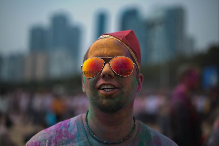 A man takes part in Holi celebrations organized by members of South Korea's Indian community at Haeundae beach in the southeastern city of Busan on March 16, 2014. (Ed Jones/AFP/Getty Images)