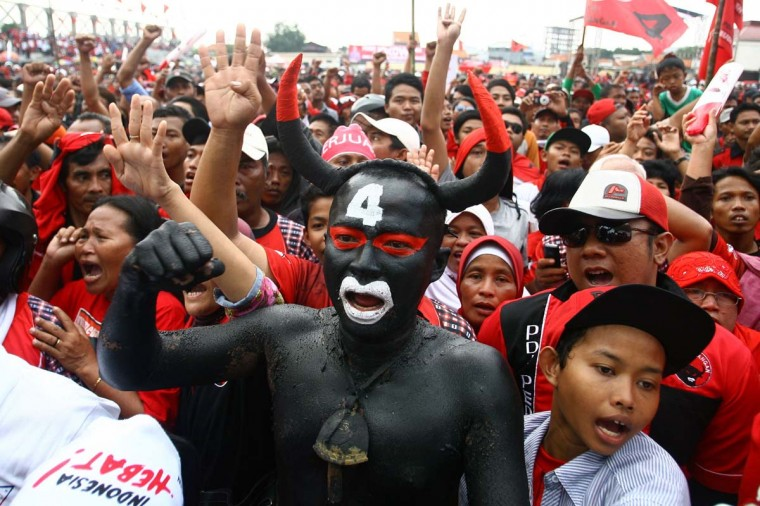 A supporter painted as the bull mascot of Indonesia's main opposition party Democratic Party of Struggle (PDI-P) shouts slogans in a rally during the first week of the campaign for the legislative election in Surabaya, eastern Java island on March 17. Indonesia, the world's biggest Muslim-majority nation with 250 million people, will hold legislative polls in April and elect a new president in July, with some 180 million voters eligible to take part.   || CREDIT:  JUNI KRISWANTO - AFP/GETTY IMAGES
