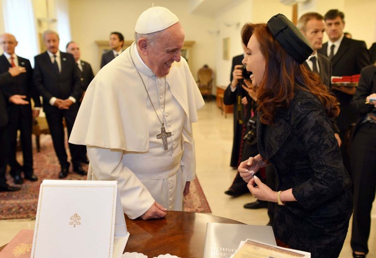 Pope Francis and Argentina's President Cristina Fernandez de Kirchner exchange gifts during a private audience at the Vatican on March 17.   || CREDIT: ALBERTO PIZZOLI - AFP/GETTY IMAGES
