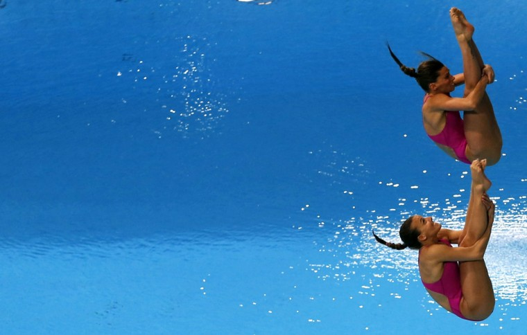 Tania Cagnotto and Francesca Dallape of Italy dive in the Women's 3M Synchro Springboard Final during the FINA/NVC Diving World Series 2014 at the Hamdan Sports Complex on March 20, 2014 in Dubai. (Karim Sahib/AFP/Getty Images)