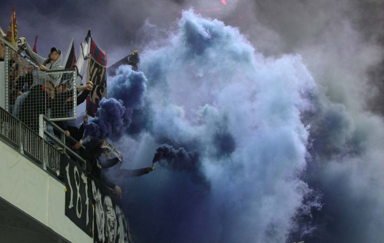 Supporters of FC Basel use smoke during the UEFA Europa League round of 16 second-leg football match between FC Basel and FC Salzburg in the stadium in Salzburg, Austria, on March 20, 2014. (Christof Stache/AFP/Getty Images)
