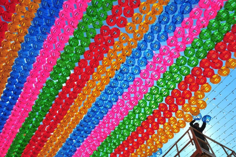 A South Korean worker sets lotus lanterns at Jogye Temple in Seoul on March 21, 2014 ahead of celebrations marking Buddha's birthday on May 6. Buddhism is one of South Korea's largest and most active religions with millions of followers. Although the exact date is unknown, Buddha's official birthday is celebrated on April 8th of the lunar calendar in South Korea. (Jung Yeon-Je//AFP/Getty Images)