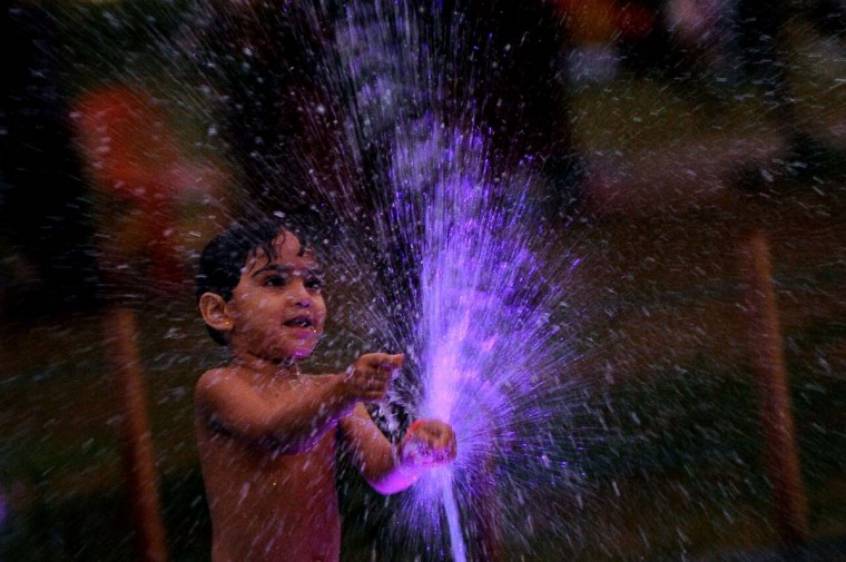 A Sri Lankan child plays in a water fountain at a children's park in Colombo on March 21, 2014, on the eve of World Water Day. International World Water Day is held annually on March 22 to focus global attention on the importance of water and advocating for the sustainable management of our water resources. (Ishara Kodikara/AFP/Getty Images)