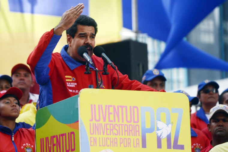 Venezuelan President Nicolas Maduro addresses supporters during a mass meeting in Caracas on March 22, 2014. For more than six weeks, Maduro and his government have been the target of near-daily protests fueled by public anger over soaring crime, hyperinflation and shortages of such basic goods as toilet paper (Leo Ramirez/AFP/Getty Images)