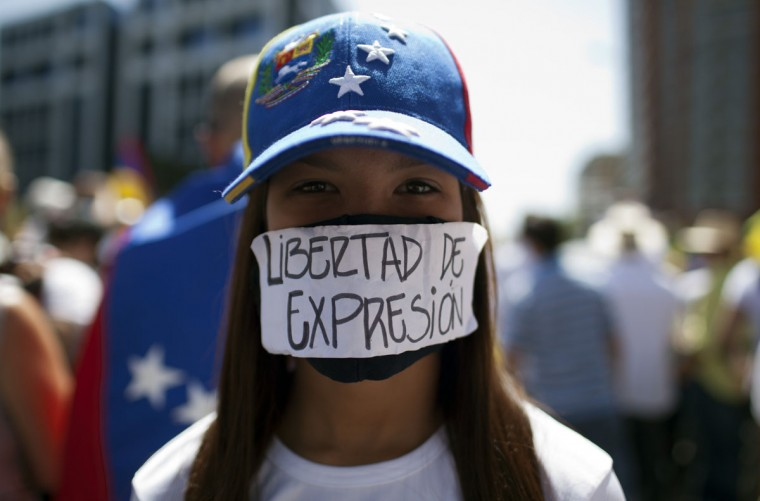 "A demonstrator protests against the government of government of Venezuelan President Nicolas Maduro with a sign on her mouth reading ""Freedom of expression,"" in Caracas, on March 22, 2014. (Federico Parra/AFP/Getty Images)"