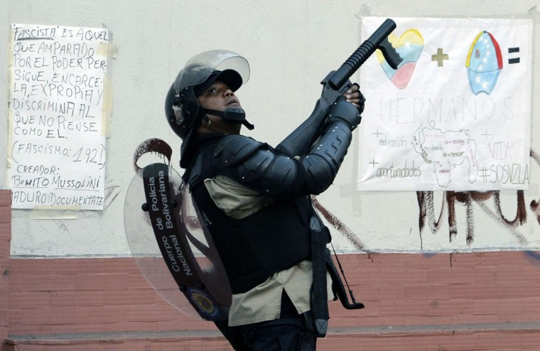 A riot policeman stands guard during a protest against Venezuelan President Nicolas Maduro in Caracas, on March 22, 2014. (Juan Barreto/AFP/Getty Images)