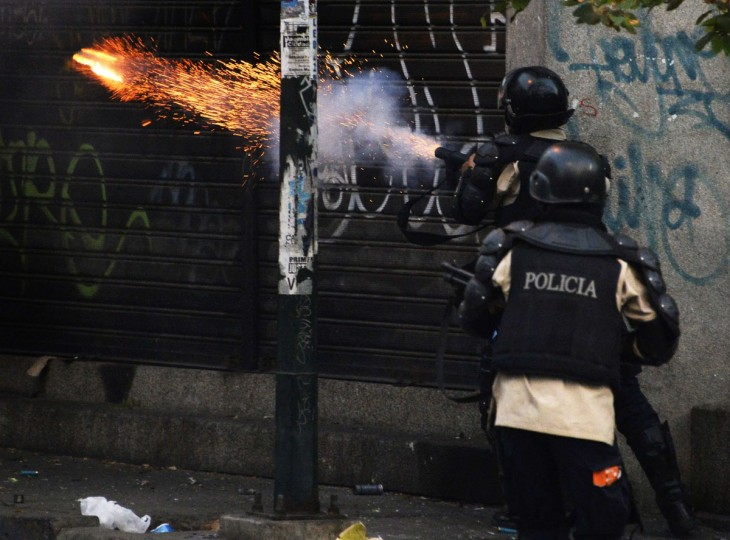 Riot policemen shoot tear gas during a protest against Venezuelan President Nicolas Maduro in Caracas, on March 22, 2014. (Juan Barreto/AFP/Getty Images)