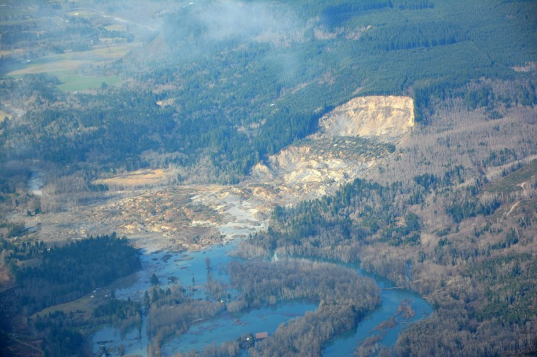 This photo obtained March 25, 2014, courtesy of the Washington State Department of Transportation shows an aerial view of the Stillguamish River and SR 530 taken near Oso, Washington, on March 22, 2014. The death toll from the devastating US landslide remained at 14 on March 25, 2014, but was expected to rise with more than 150 people listed missing, as the National Guard joined the massive rescue effort.The number of people unaccounted for after Saturday's disaster in the tiny town of Oso in Washington state still stood at 176, although officials stressed that the figure should not be taken as a death toll. (Washington State Department of Transportation/Getty)