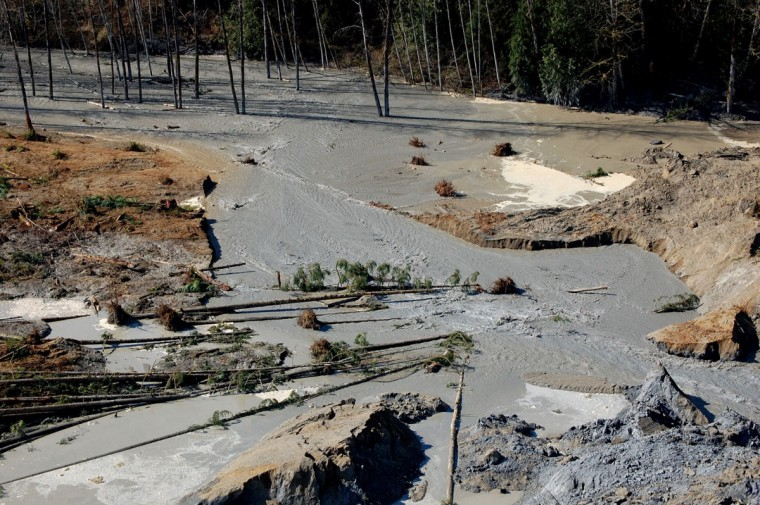 This photo obtained March 25, 2014, courtesy of the Washington State Department of Transportation shows the Stillaguamish dam breach at SR 530, created after the landslide near Oso, Washington, on March 22, 2014. The death toll from the devastating US landslide remained at 14 on March 25, 2014, but was expected to rise with more than 150 people listed missing, as the National Guard joined the massive rescue effort.The number of people unaccounted for after Saturday's disaster in the tiny town of Oso in Washington state still stood at 176, although officials stressed that the figure should not be taken as a death toll. (Washington DOT/Getty)