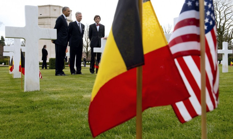 """A handout picture released by the Chancellery of Belgium's Prime Minister shows (L-R) US President Barack Obama, Belgium's King Philippe and Belgian Prime Minister Elio Di Rupo visiting the WWI Flanders Field Cemetery in Waregem on March 26, 2014. Obama paid his first visit ever to the European Union headquarters in Brussels, cementing US-EU opposition to the takeover of Crimea after slamming Russian expansionism as a """"sign of weakness"""". (Prime Minister's Chancellery/Benoit Doppange/AFP/Getty Images)"""