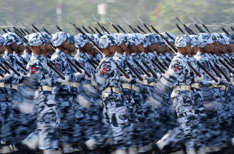 Members of Myanmar's military march in formation during a ceremony to mark the 69th anniversary of Armed Forces Day in Myanmar's capital Naypyidaw on March 27, 2014. (Ye Aung Thu/AFP/Getty Images)