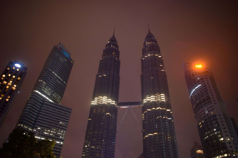 A general view shows the Petronas towers in Kuala Lumpur after the lights of have been switched off for earth hour on March 29, 2014. (ED JONES/AFP/Getty Images)