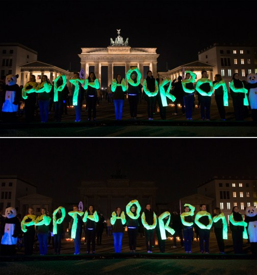 The combo picture shows activists of World Wide Fund (WWF) posing in front of the Brandenburg Gate during the Earth Hour environmental campaign in March 29, 2014 in Berlin. (JOHANNES EISELE/AFP/Getty Images)