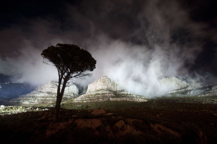 The lights shine on Table Mountain just before being turned off for the global Earth Hour intitiative, on March 29, 2014, in Cape Town. (RODGER BOSCH/AFP/Getty Images)