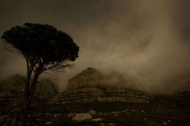 Table Mountain is plunged into darkness for the global Earth Hour intitiative, on March 29, 2014, in Cape Town. (RODGER BOSCH/AFP/Getty Images)