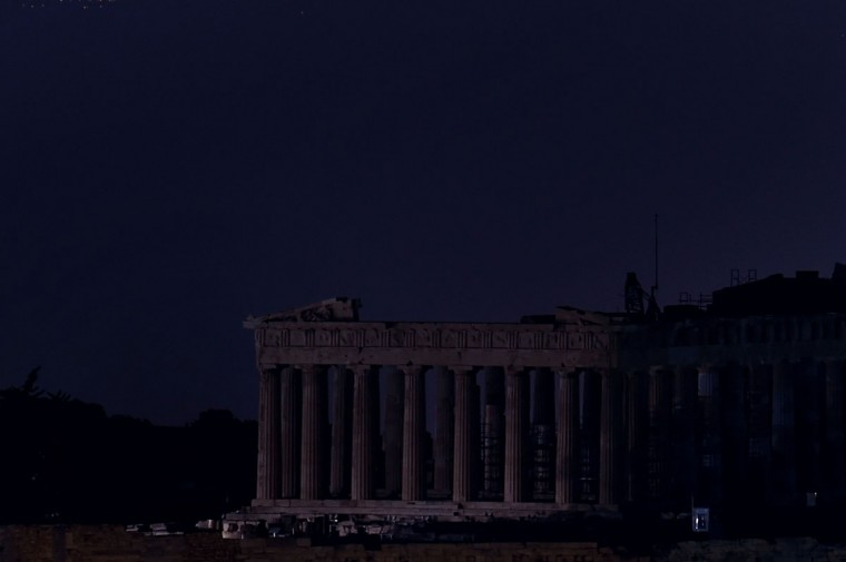 This picture shows the ancient Temple of Parthenon atop the Acropolis hill in the dark during the Earth Hour initiative in Athens on March 29, 2014. (ARIS MESSINIS/AFP/Getty Images)