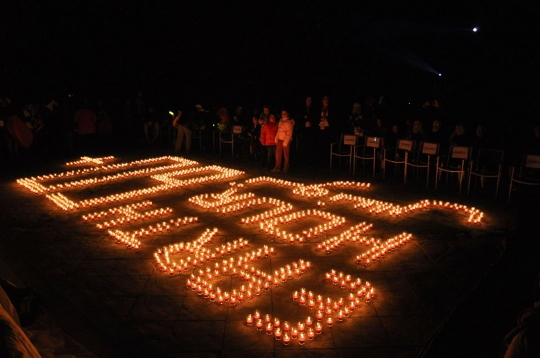 "People surround lit candles forming the number ""60"" and reading earth hour"" during the Earth Hour event on March 29, 2014 at the Roman amphitheater of Carthage on the outskirts of Tunis. (YOSRA BEN HASSINE/AFP/Getty Images)"