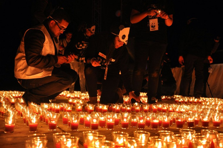 Tunisians light candles during the Earth Hour on March 29, 2014 at the Roman amphitheater of Carthage on the outskirts of Tunis. (YOSRA BEN HASSINE/AFP/Getty Images)