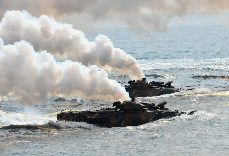 South Korean Marine amphibious assault vehicles land on the seashore during a joint landing operation with U.S. Marines in Pohang. (JUNG YEON-JE/AFP/Getty Images)