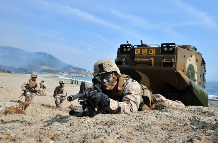 U.S. Marines take a position during a joint landing operation with South Korean Marines in Pohang. (JUNG YEON-JE/AFP/Getty Images)