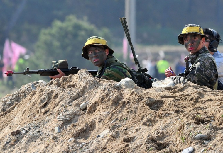 South Korean Marines take a position on a beach during a joint landing operation with U.S. Marines in Pohang. (JUNG YEON-JE/AFP/Getty Images)