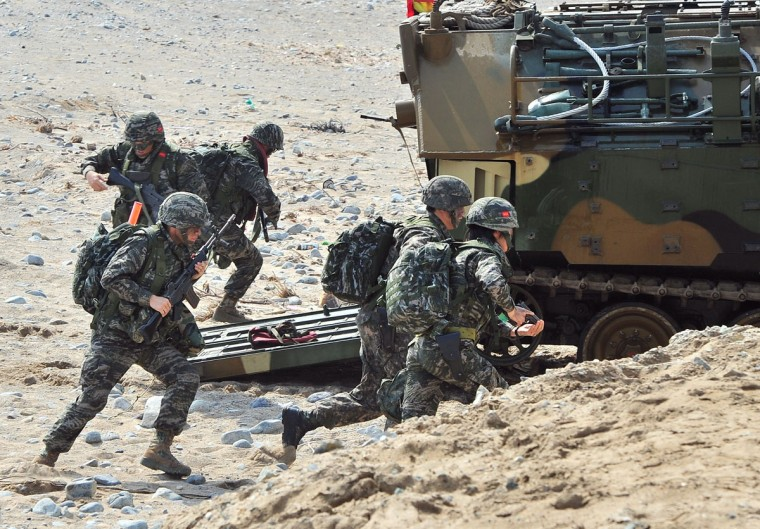South Korean Marines exit an amphibious assault vehicle during a joint landing operation by US and South Korean Marines in Pohang on March 31, 2014. (JUNG YEON-JE/AFP/Getty Images)