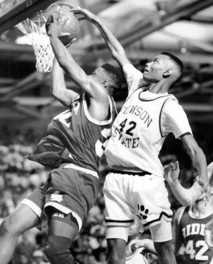 March 5, 1991 - Towson State U. vs. Rider College in ECC basketball final. John James effectively blocked Rider's William Kinsel in the final minutes of the first half. (Amy Davis/Baltimore Sun)