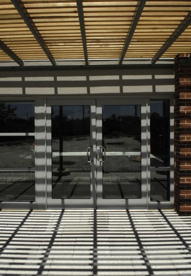 A lattice roof provides shade off of a lounge on an outdoor terrace. (Jed Kirschbaum/Baltimore Sun)