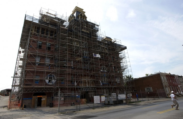 The long-dormant American Brewery building on Gay Street is slowly returning to form as a painstaking restoration continues. A Howard County group is bringing 250 jobs to the neighborhood. (Christopher T. Assaf/Baltimore Sun)