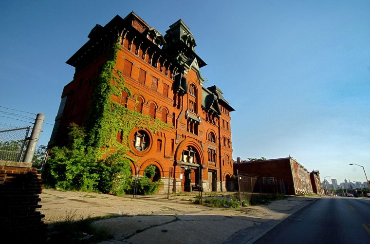 The vacant American Brewery, reaching into the Baltimore sky since 1863, stands as shadows creep towards the building in the afternoon sun on Gay Street on May 10, 2006. (Baltimore Sun/Karl Merton Ferron)