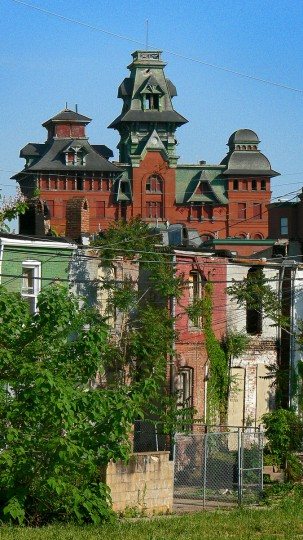 The vacant American Brewery, reaching into the Baltimore sky since 1863, looms over the rear of several vacant homes on the southern side of North Avenue in a view across from Castle St. on May 10, 2006. (Baltimore Sun Staff/Karl Merton Ferron)