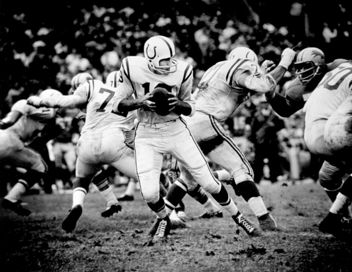 Johnny Unitas of the Baltimore Colts drops back to pass as he plays against the Detroit Lions in 1965. (Paul Hutchins/Baltimore Sun)