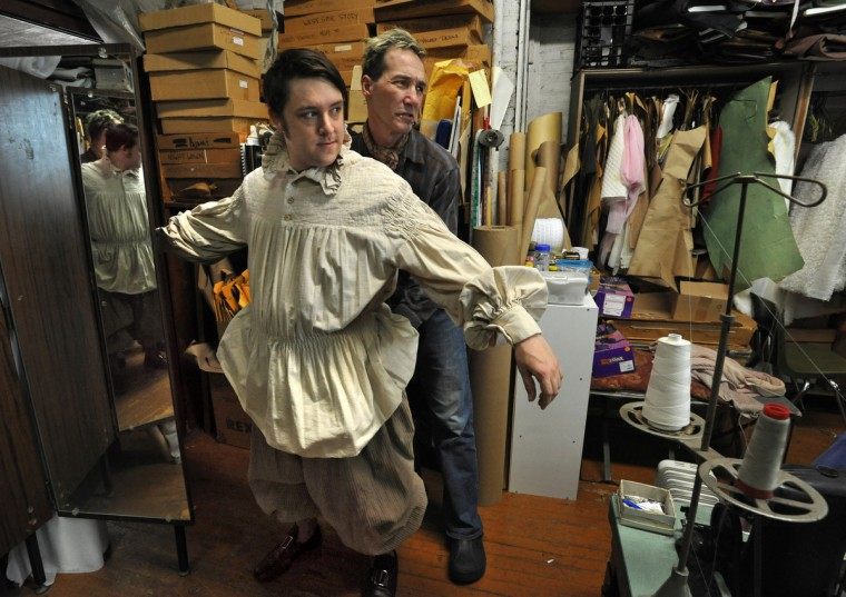 "Corbin Phillips, left, in the masters program at Peabody Conservatory, gets fitted by costume designer John Bernatitus, right, for his role as Quince in the upcoming Peabody Opera Theatre production of Benjamin Britten: ""Midsummer Night's Dream."" The A.T. Jones & Sons costume company was founded in Baltimore in 1868. (Amy Davis / Baltimore Sun)"
