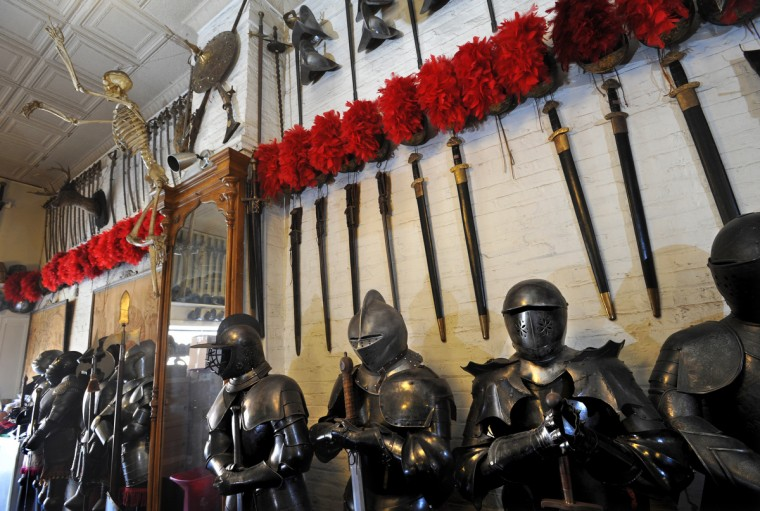 Customers are greeted at the entrance of the costume shop with an imposing line-up of swords, helmets and suits of armor, including fiberglass replicas and Victorian antiques. (Amy Davis / Baltimore Sun)