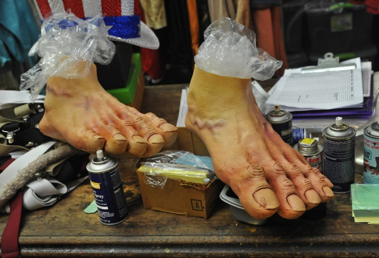 Fred Flintstone feet sit on a table. They will be used for an upcoming show in Washington D.C. (Amy Davis / Baltimore Sun)
