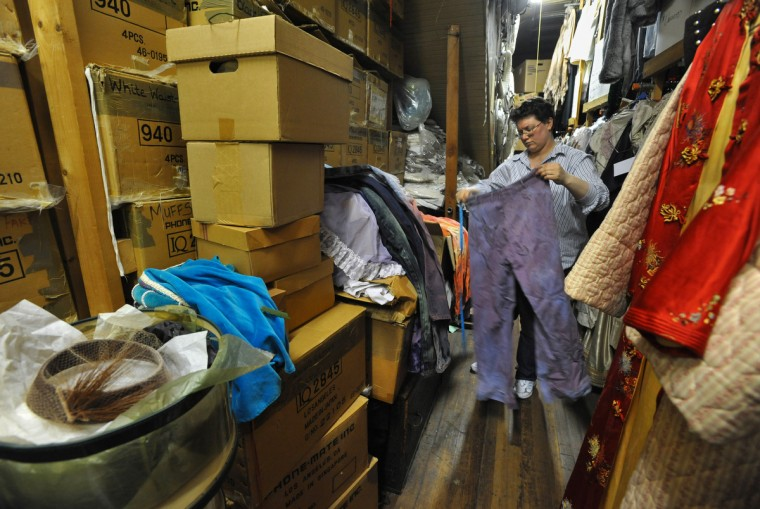 Mary Bova checks the large stockroom upstairs for hippie pants for an upcoming show. The organization of the storage areas for costumes is mysterious, but Bova knows where to find anything. (Amy Davis / Baltimore Sun)