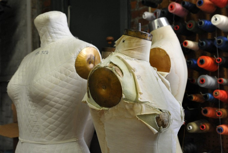 Dress forms and spools of thread are tucked into a corner of the work room where the costumes are fabricated. (Amy Davis / Baltimore Sun)