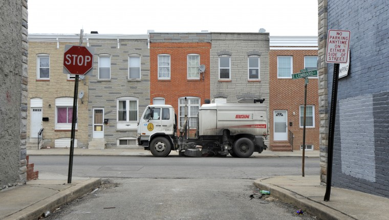 \Street sweeping will begin across the city for the first time, as Baltimore officials expand a program that has long been restricted to the central region of the city. Here a street sweeper moves along the 3400 block of E. Lombard St. (Lloyd Fox/Sun Photographer)