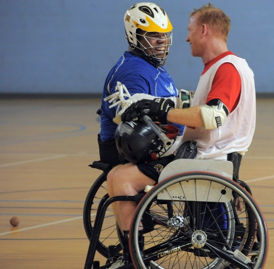 "Left to right, Larry Toler, 55, Baltimore, and Mark Flounlacker, Ocean Pines, founder of FreeState Wheelchair Lacrosse, share a smile during a break in play in a scrimmage during a Wheelchair Lacrosse Clinic. Toler who contracted polio when he was 17 months old, has played wheelchair basketball for 38 years, but this is his first time playing lacrosse. He says ""As you get older you always want to try something new. Today is a new day, an adventure."" (Kim Hairston/Baltimore Sun)"