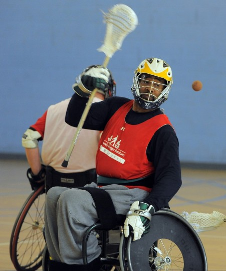 Andre McDonald, 49, Columbia, a T 4-5 paraplegic, makes a pass during a scrimmage during a Wheelchair Lacrosse Clinic. (Kim Hairston/Baltimore Sun)