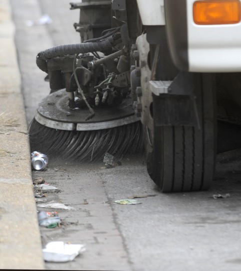 Street sweeping will begin across the city for the first time, as Baltimore officials expand a program that has long been restricted to the central region of the city. Here a street sweeper moves along the 3400 block of E. Lombard St. (Lloyd Fox/Sun Photographer)