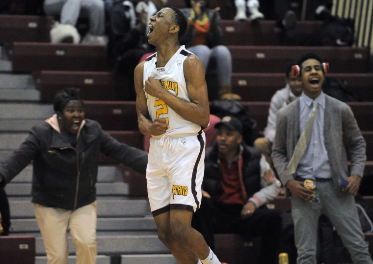 In a game against the Dulaney Lions, New Town guard/forward Kenny Sherrod (2) celebrates his buzzer-beating 3-pointer. (Karl Merton Ferron/Baltimore Sun)