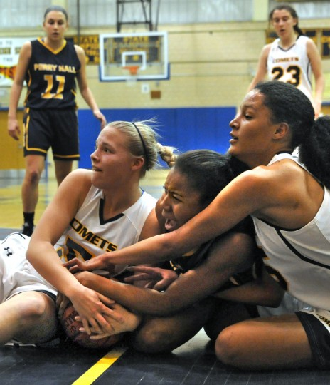 From left, Catonsville's Lauren McDonald, Perry Hall's Shawnika McCallum, and Catonsville's Maja Wichhart battle for a loose ball. (Amy Davis/Baltimore Sun)