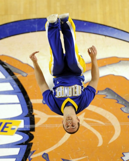 University Delaware cheerleader performs a backflip on the court. Men's 2014 CAA basketball tournament championships. University of Delaware vs. William & Mary at the Baltimore Arena . (Lloyd Fox/Baltimore Sun)