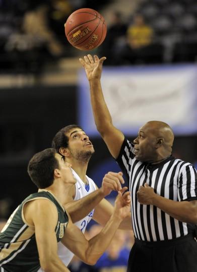 University of Delaware's #33 Carl Baptiste eyes the opening tip of CAA Men's 2014 basketball tournament championship game. (Lloyd Fox/Baltimore Sun)