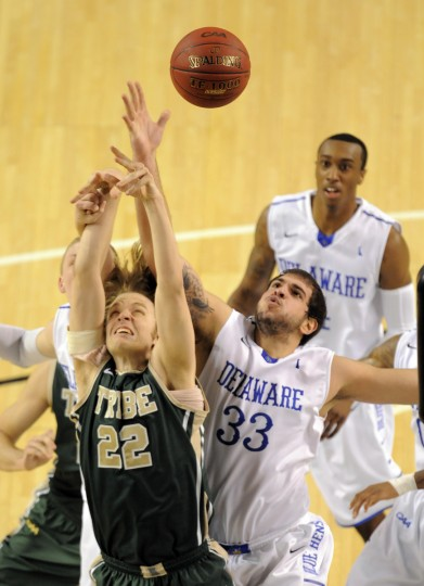 William & Mary #22 Tim Rusthoven and Delaware #33 Carl Baptiste fight for a rebound in the first half of the men's 2014 CAA basketball tournament championships. (Lloyd Fox/Baltimore Sun)