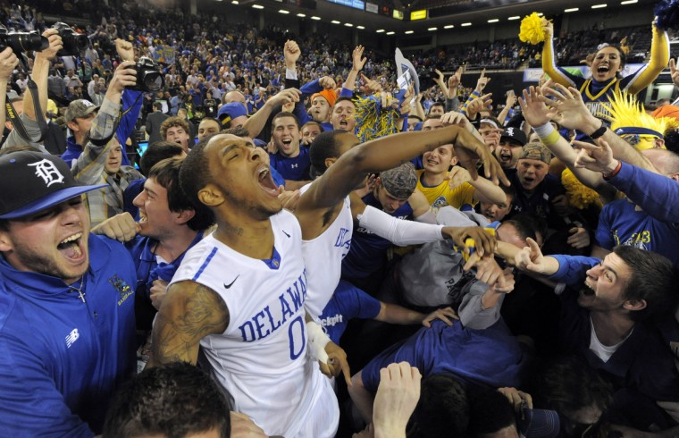 Delaware #0 Davon Usher celebrates with fans after winning the CAA tournament. (Lloyd Fox/Baltimore Sun)