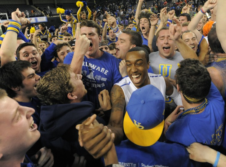 Delaware #4 Jarvis Threatt celebrates with fans after winning the CAA Men's 2014 CAA basketball tournament. (Lloyd Fox/Baltimore Sun)